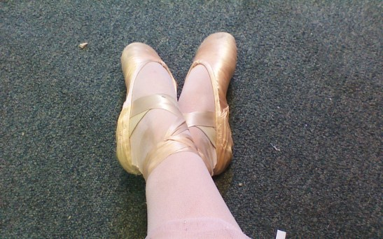 My feet in my somewhat dirty pointe shoes.